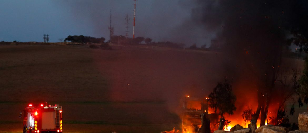 View of a bus which was set ablaze from a Anti-tank guided missile fired from the Gaza Strip, in southern Israel on November 12, 2018. Photo by Flash90